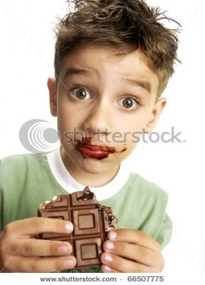 stock-photo-close-up-of-young-boy-eating-a-chocolate-bar-66507775